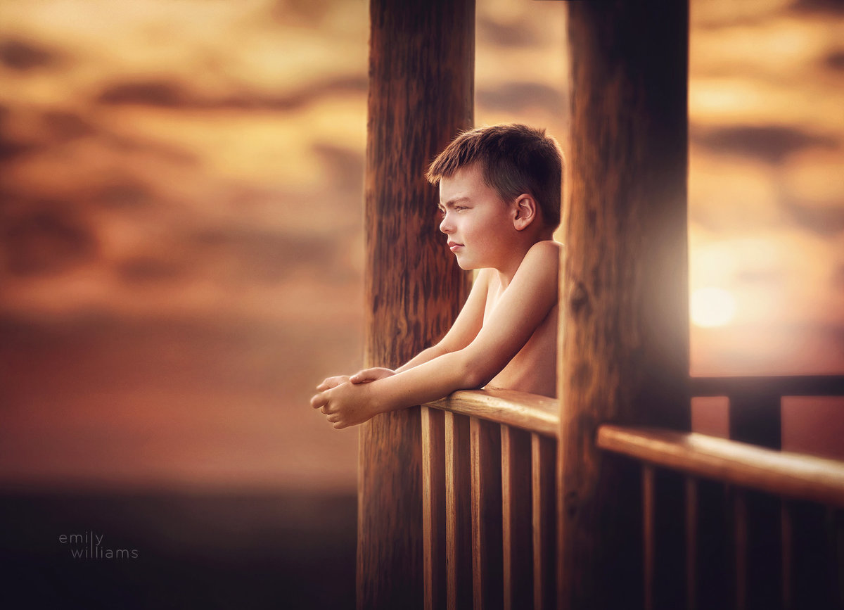 Boy in sunset