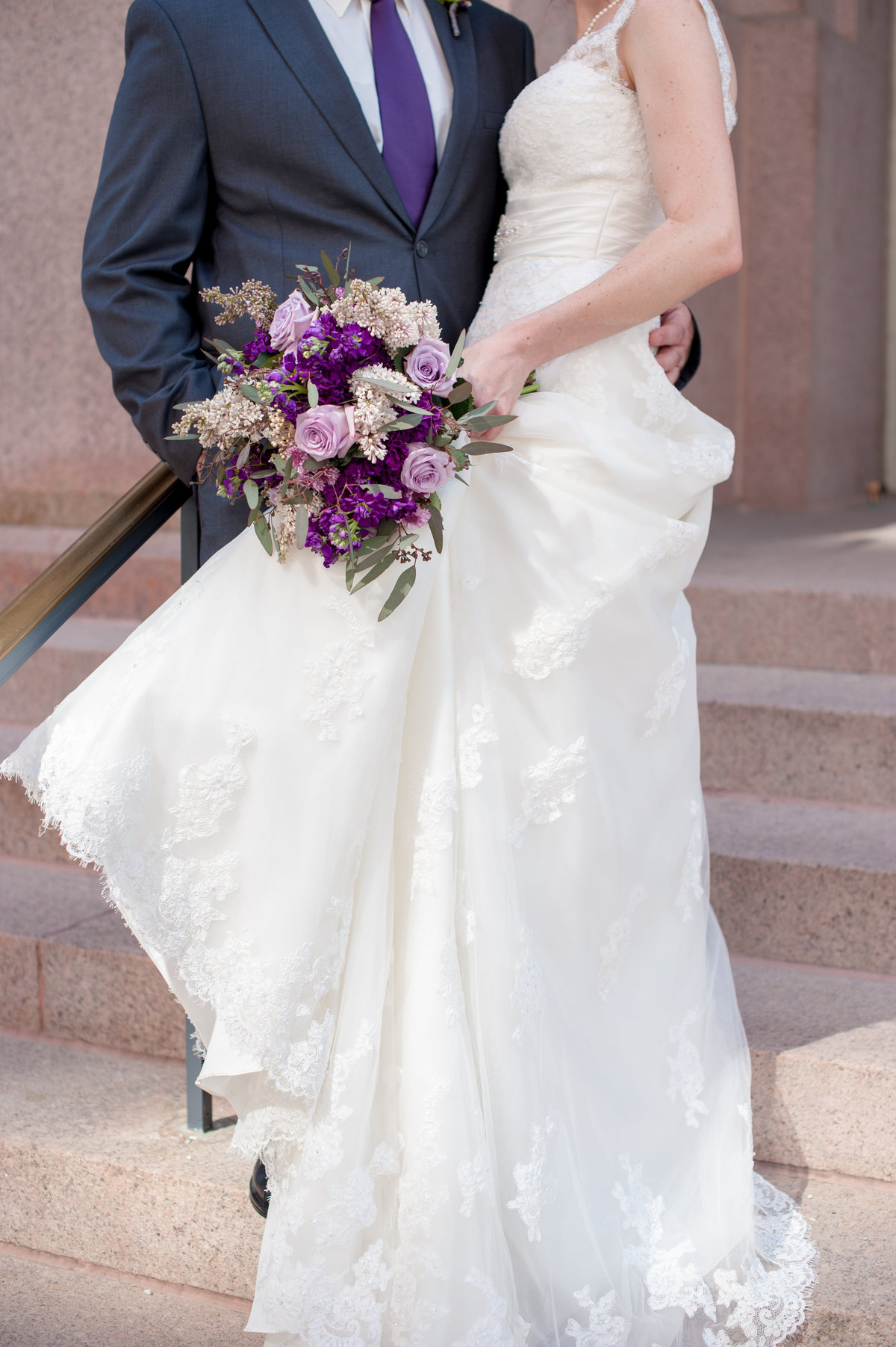 St Louis MO bride and groom with purple bouquet