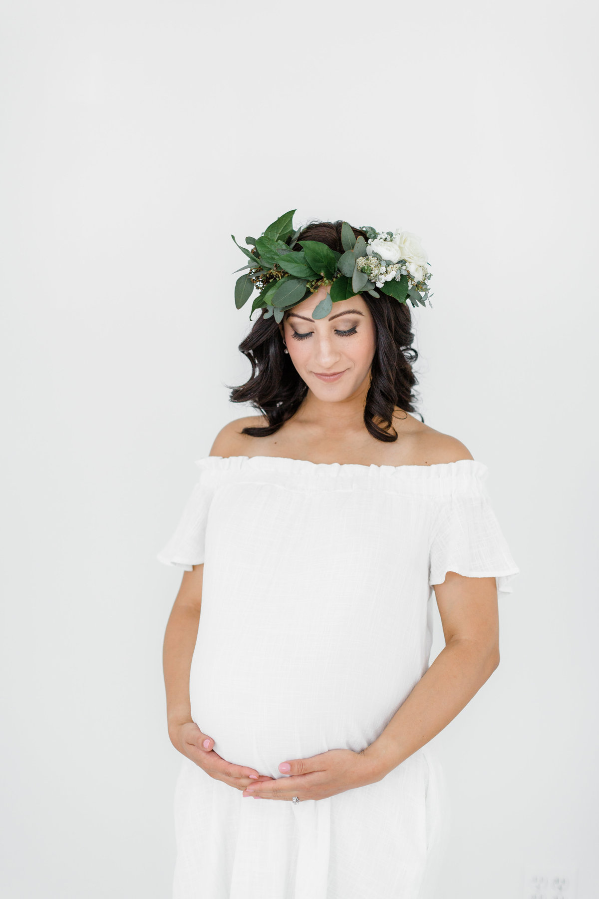 maternity session in white dress and floral crown