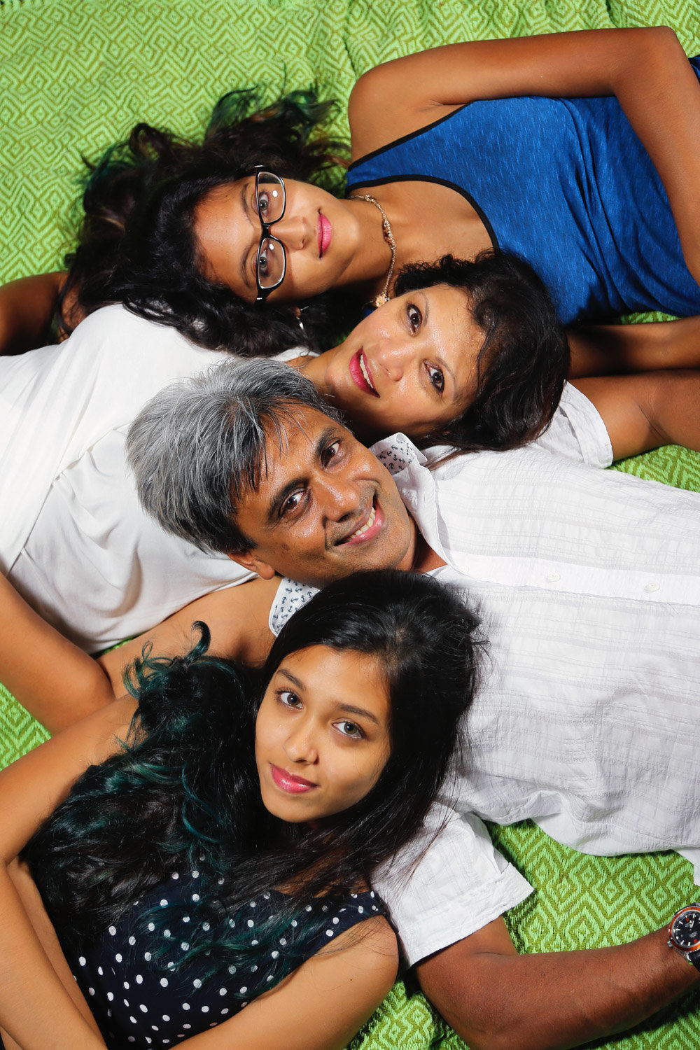 Family portrait of mom, dad, and two daughters. Photo by Ross Photography, Trinidad, W.I..