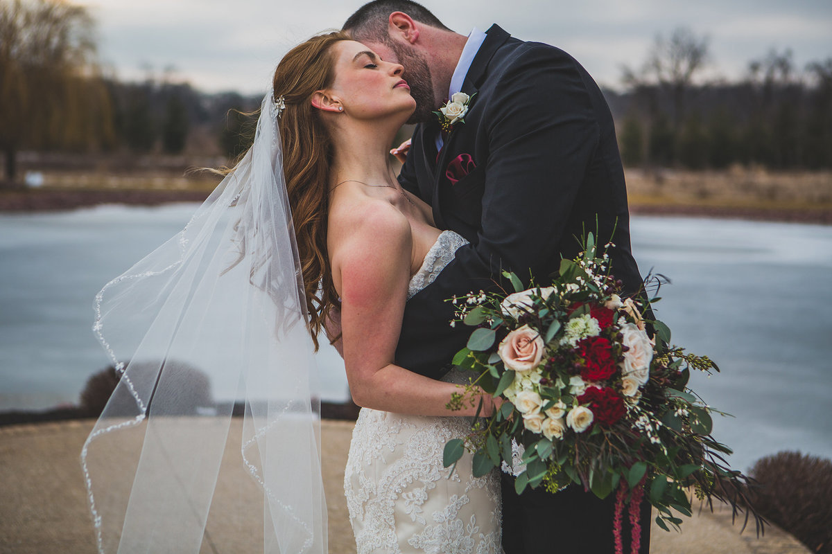 Winter wedding with bride and groom hugging