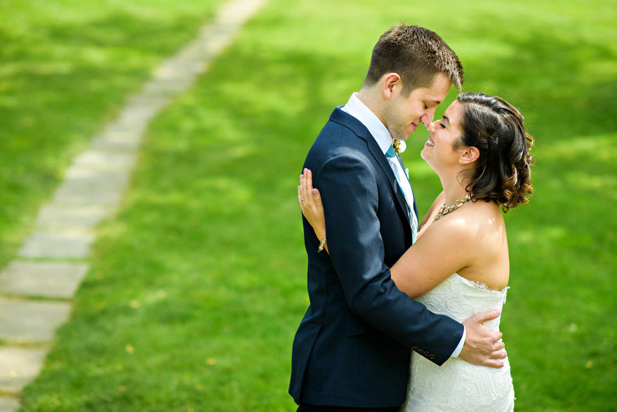 A groom hugs his bride before their ceremony at  Anthony Wayne House.