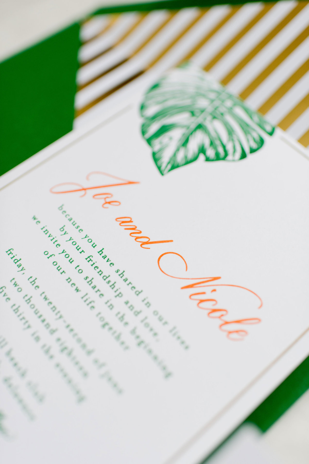 Monstera tropical hand lettered wedding invitations with envelope liner