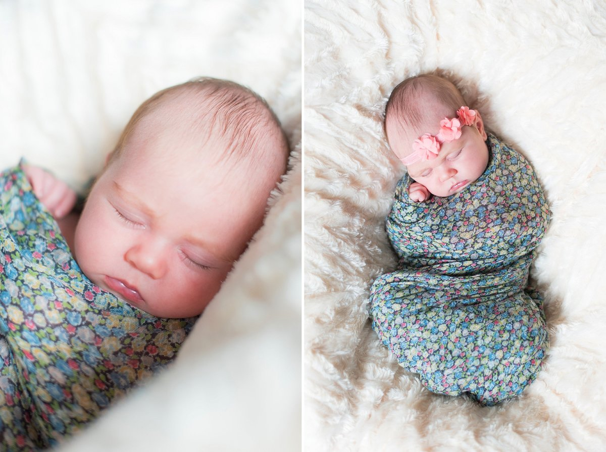 Sleeping newborn baby girl wrapped in floral and navy swaddle with coral flower headband photo