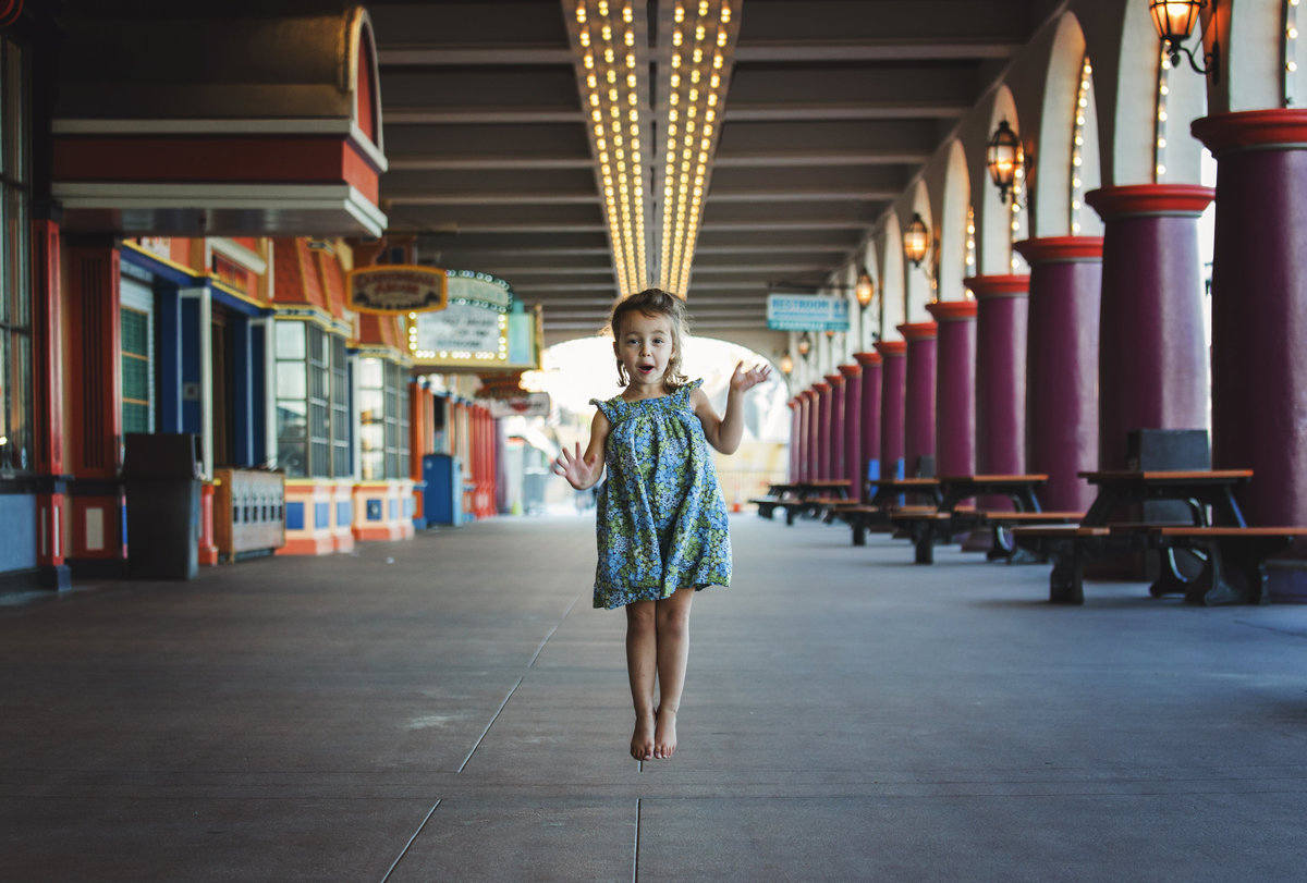 charlotte documentary photographer captures a fun portrait of a child at the boardwalk in Santa Cruz, California