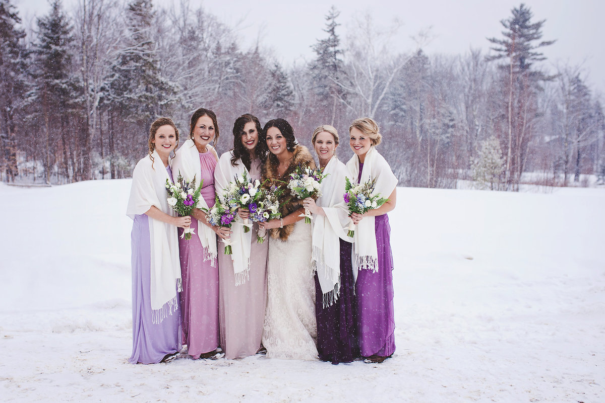 bridesmaids in shades of purple, Vermont winter wedding