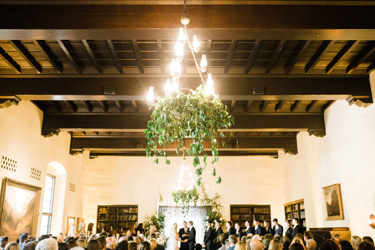 iron chandelier hanging with greenery