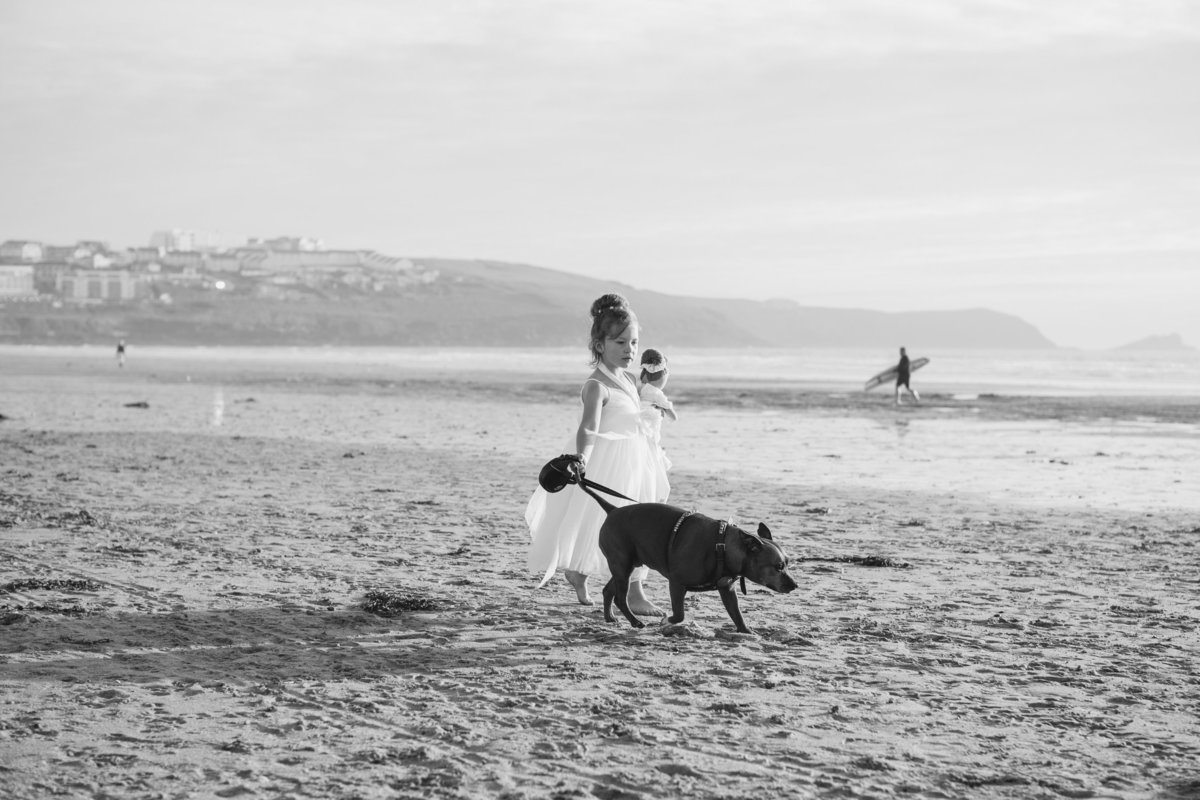 flower girl on beach in cornwall