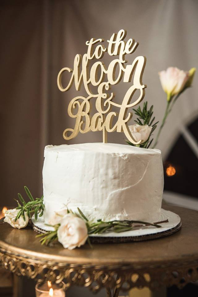 Granby-colorado-strawberry-creek-ranch-hipster-mountain-wedding-to-the-moon-and-back-cake-topper