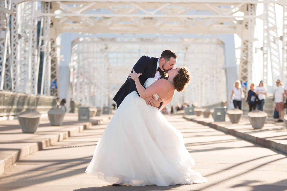 Bride and groom on pedestrian bridge