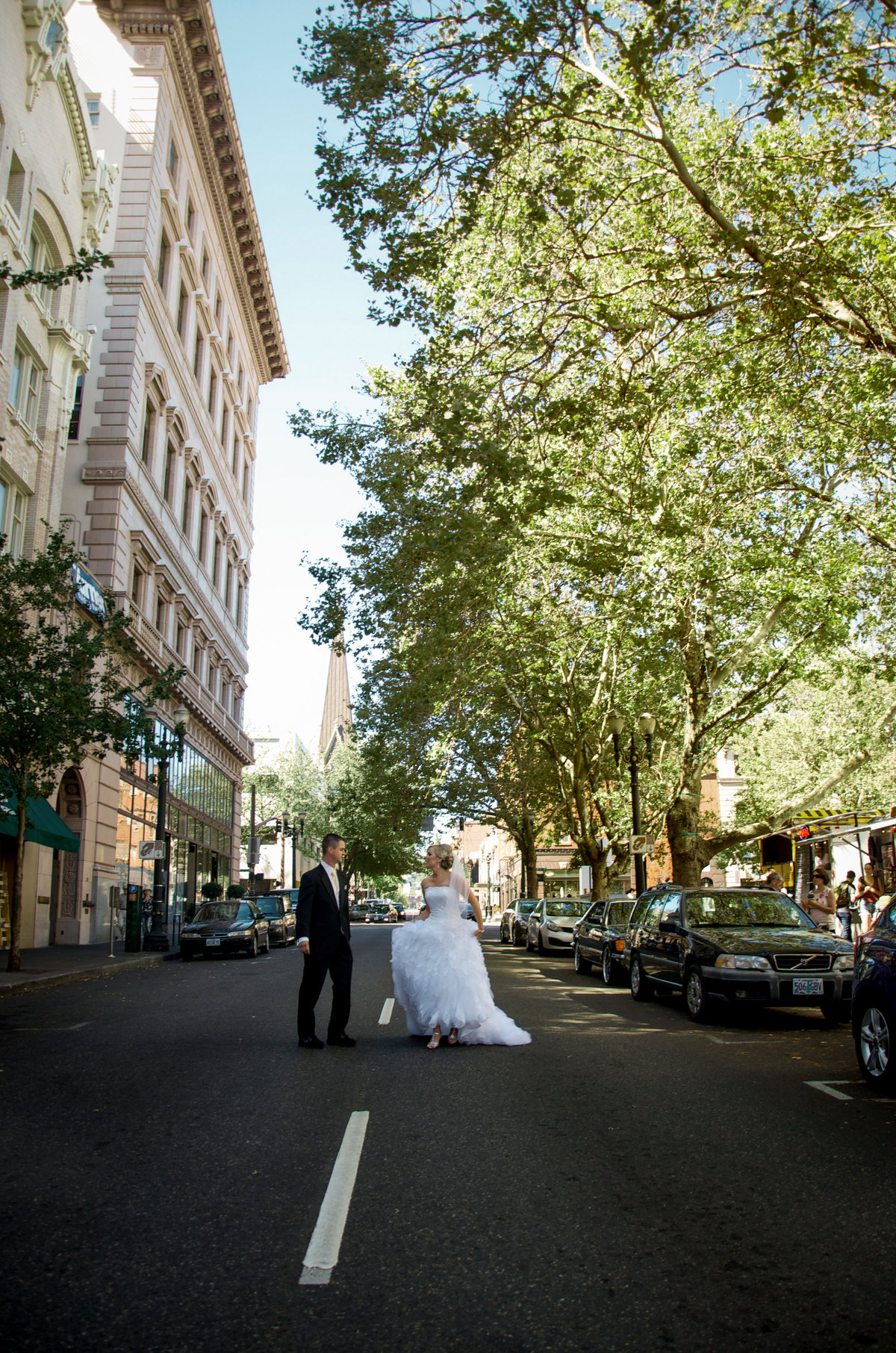 Portland OR bride and groom walking down the street