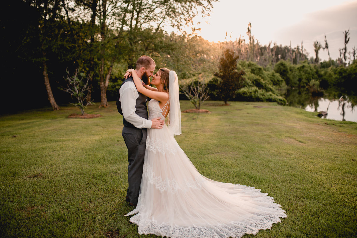 Beautiful sunset photo of bride and groom on their wedding day by Tallahassee photographer.