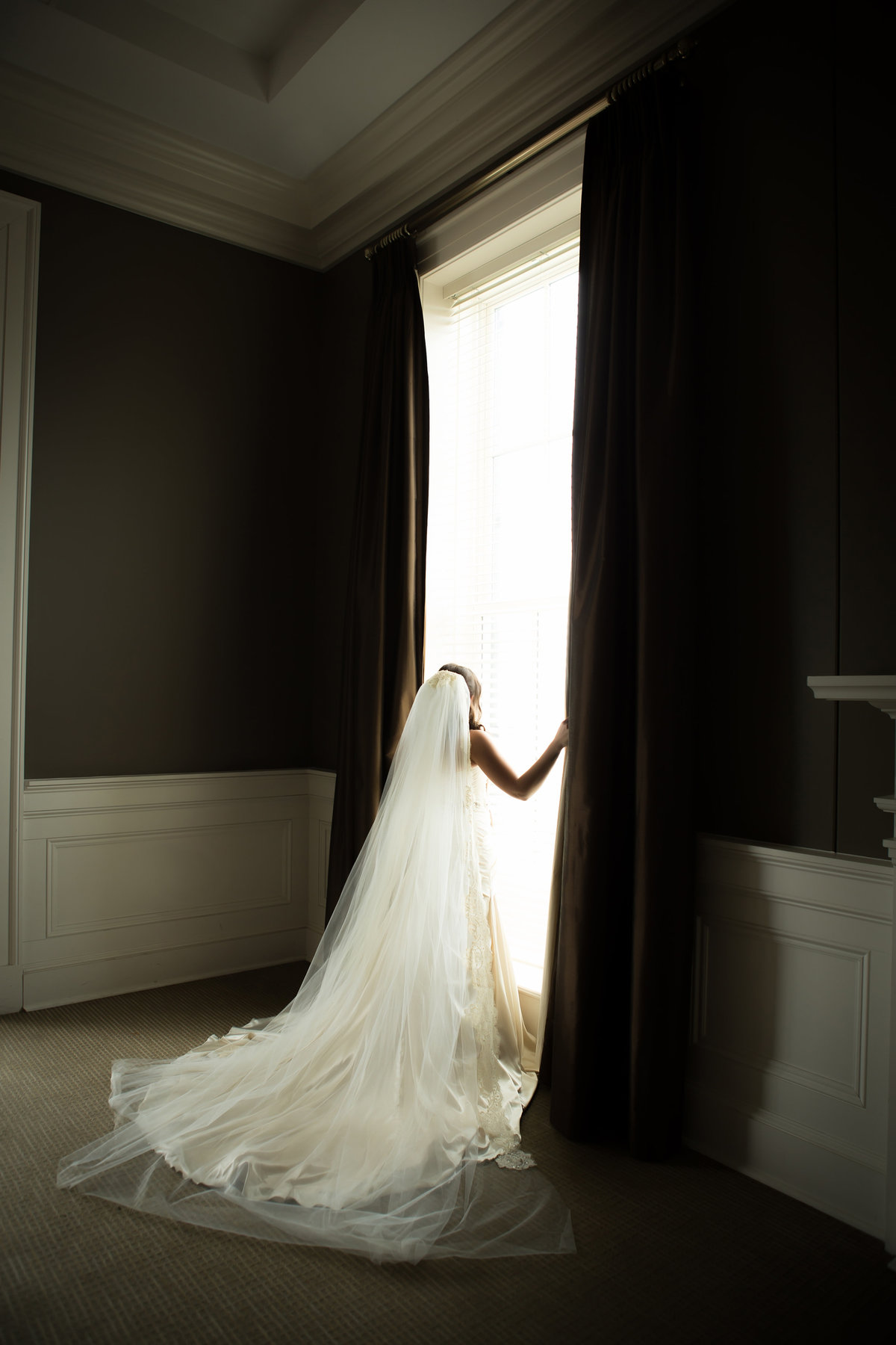 bride looking out the window at the biloxi visitors center in biloxi ms