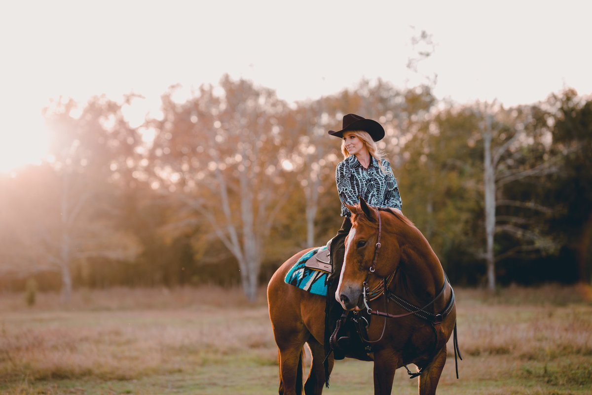 Sunset pictures of horse and rider by equestrian photographer in North Florida.