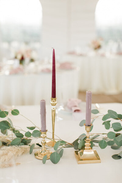 Eucalyptus and candle sticks with candles  on head table