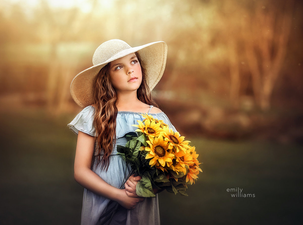 Portrait of girl with sunflowers