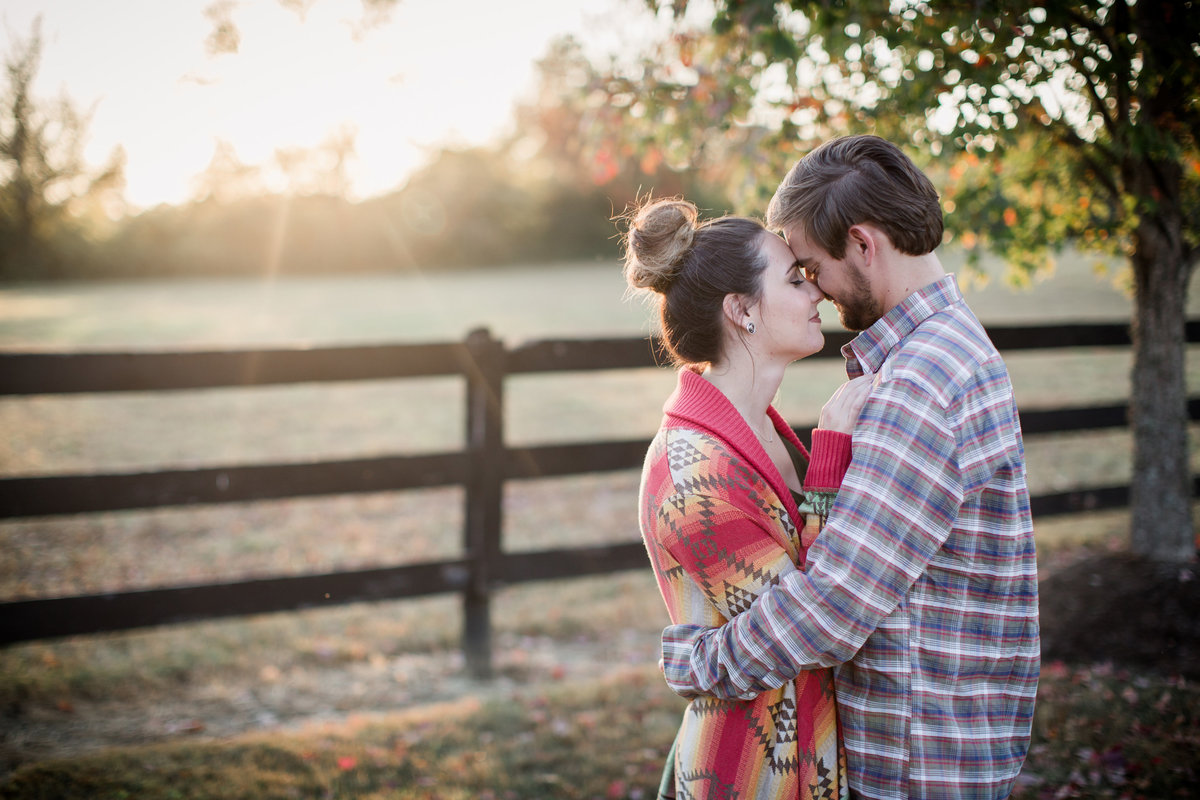 Foreheads together during a fall sunset engagement photo by Knoxville Wedding Photographer, Amanda May Photos.