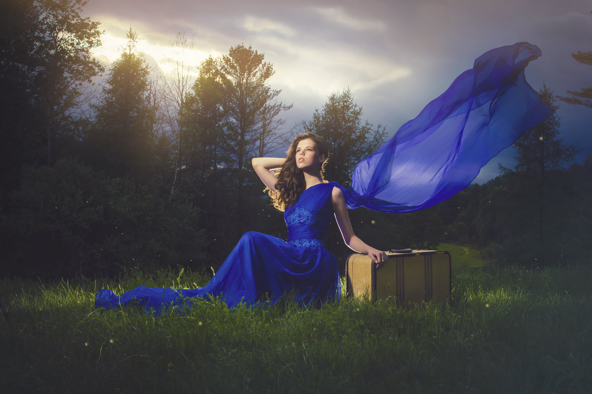 beautiful girl in blue cape dress dramatic lighting by jacob grant maui hawaii photography