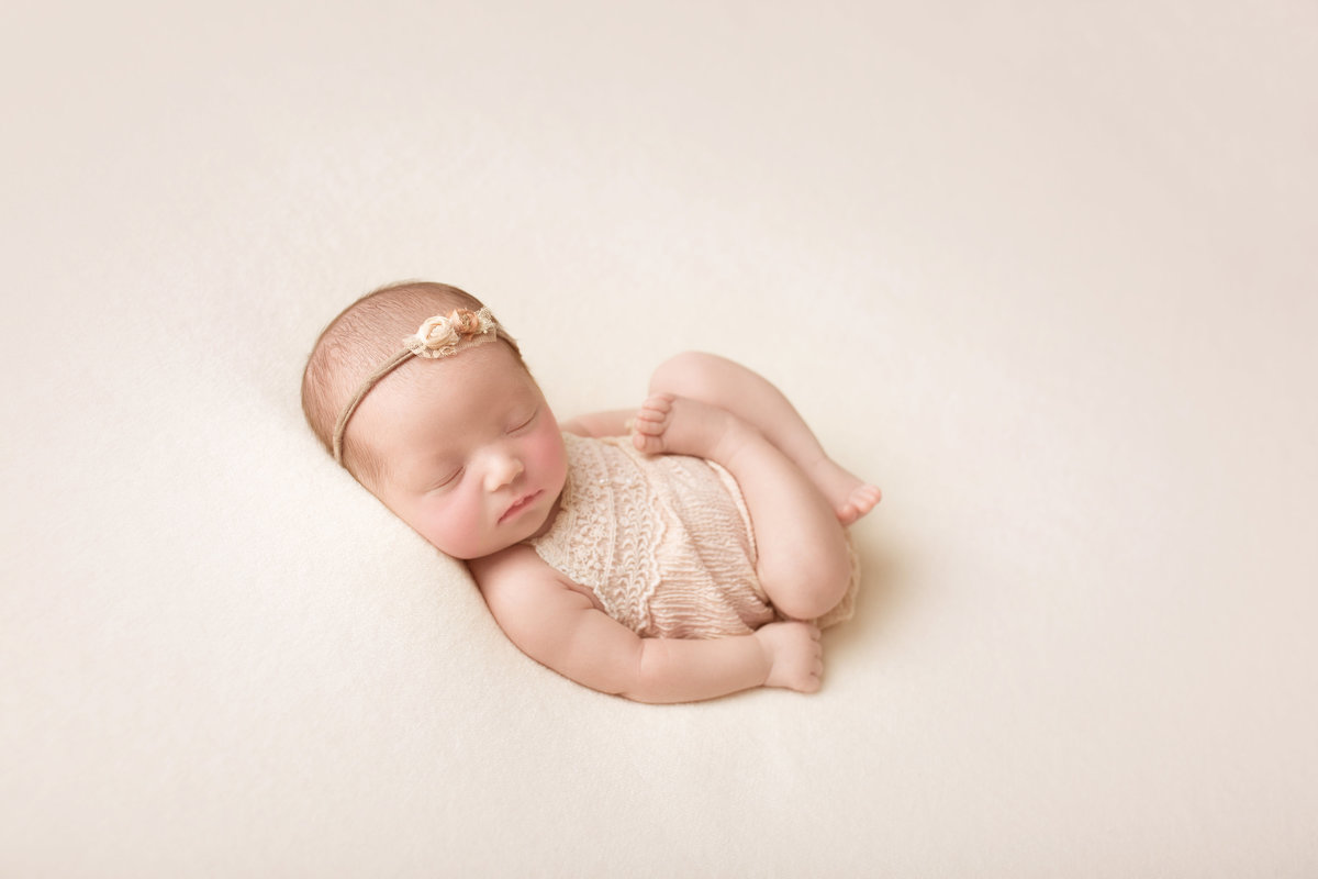 cozy newborn baby photo