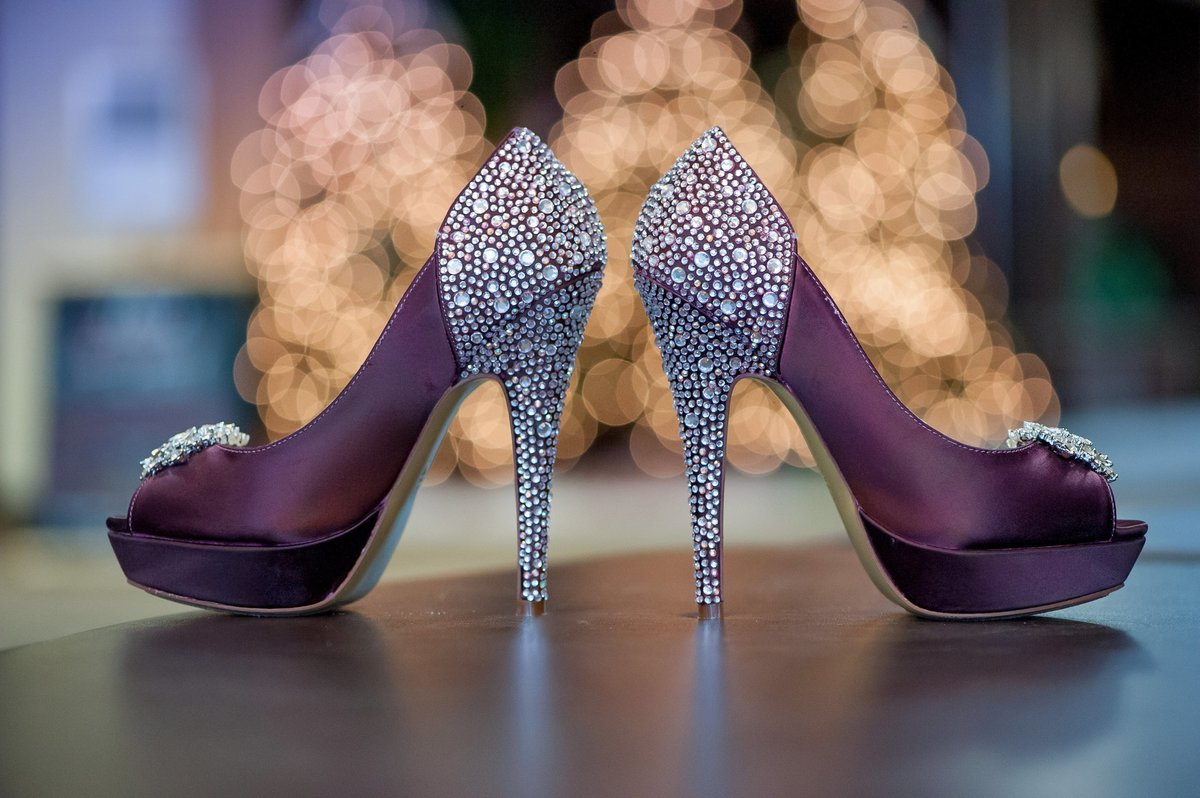 Purple wedding shoes with diamond studs and bling photos by Kris Kandel. Christmas weddings