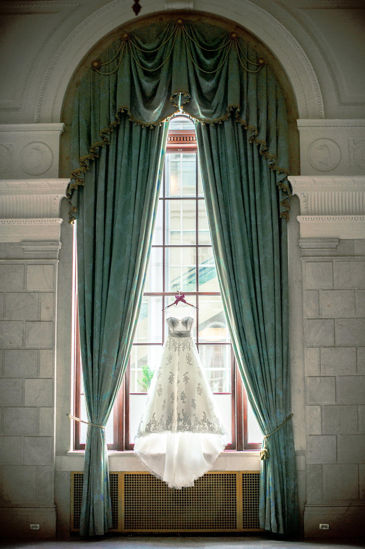 Wedding dress hanging in window at City Museum St Louis MO