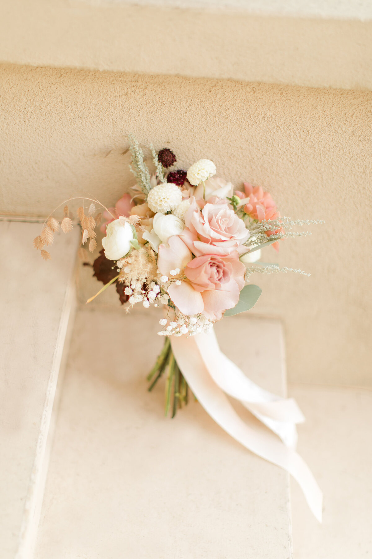 wedding bouquet with mauve burgundy white flowers