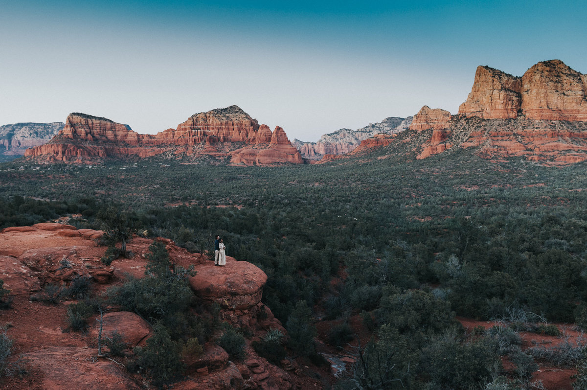 This environmental portrait of a bride and  groom during sunset in their elopement in Sedona, Arizona