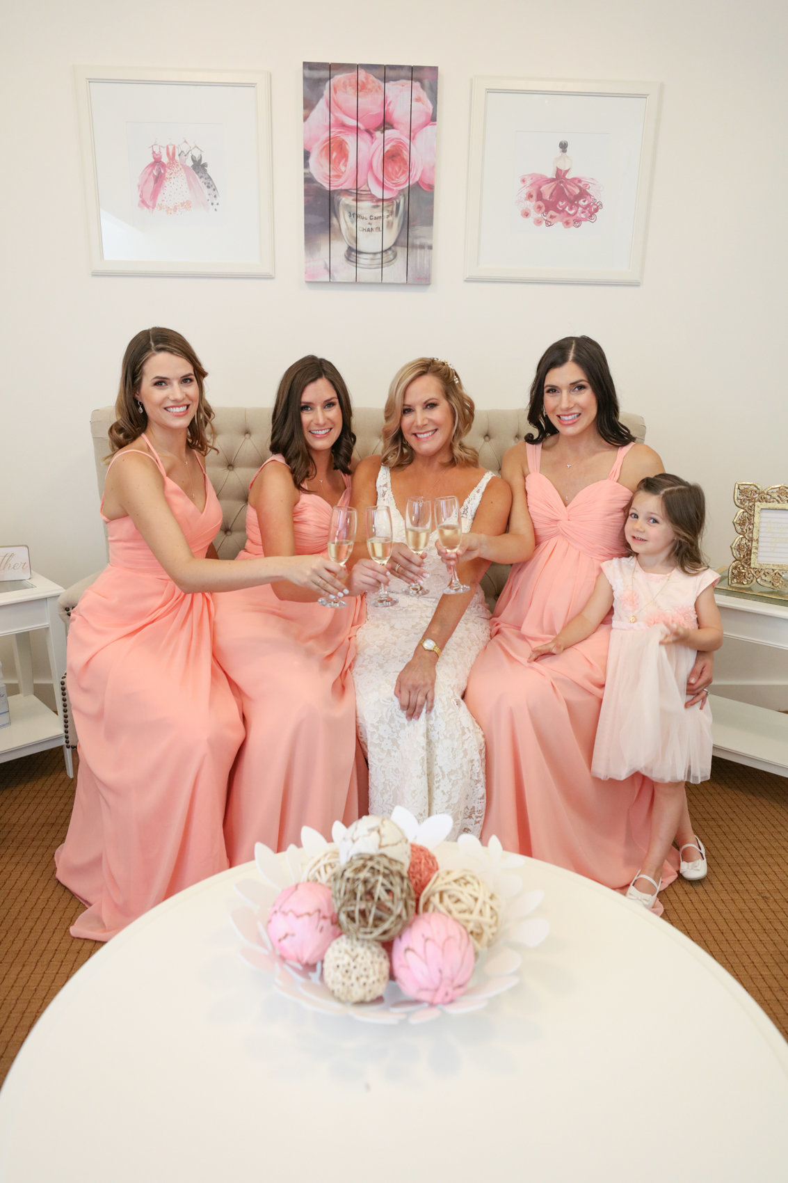 Deneffe studios wedding, portrait of bride with her bridesmaids inside
