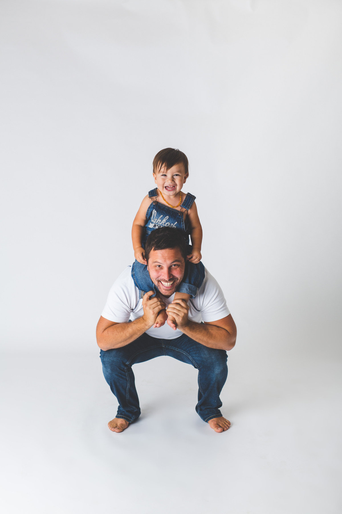 Father and son baby family session in studio on white background