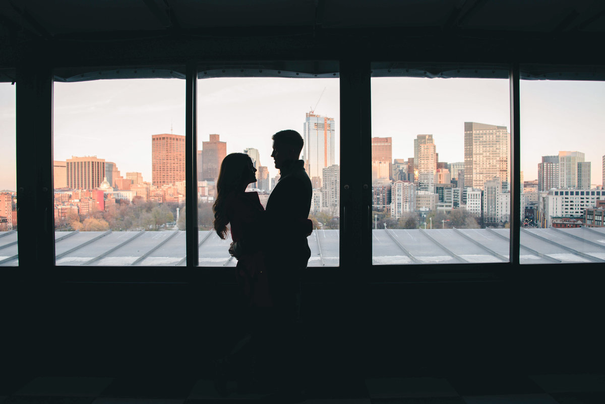 downtown engagement photo couple with  skyline