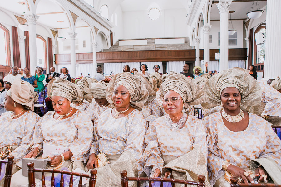 Lovely women in Nigerian outfits at church wedding