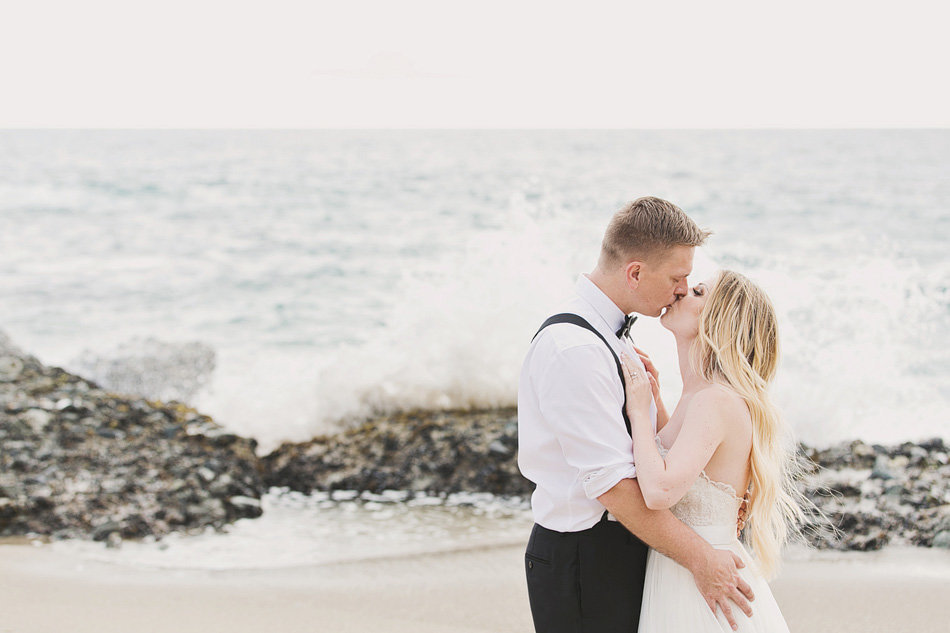 Elopement wedding of bride and groom kissing at the beach