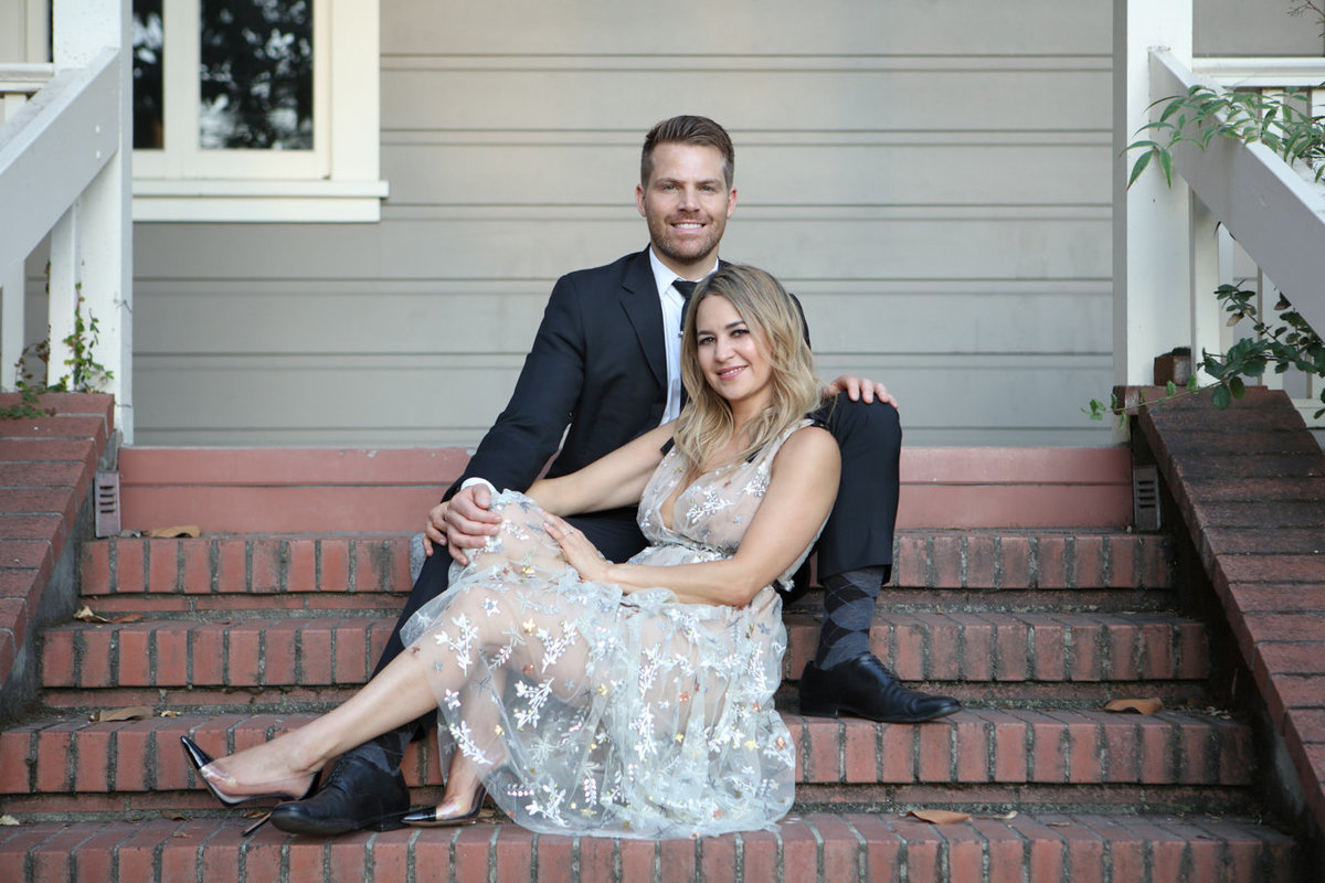 Young couple engagement portraits, rustic theme on stairs