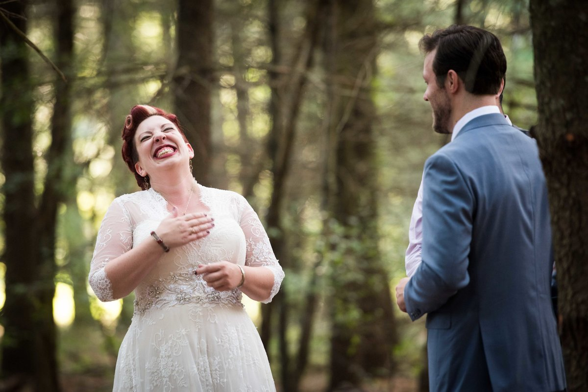 Bride laughs during outdoor forest ceremony, Hocking Hills OH.