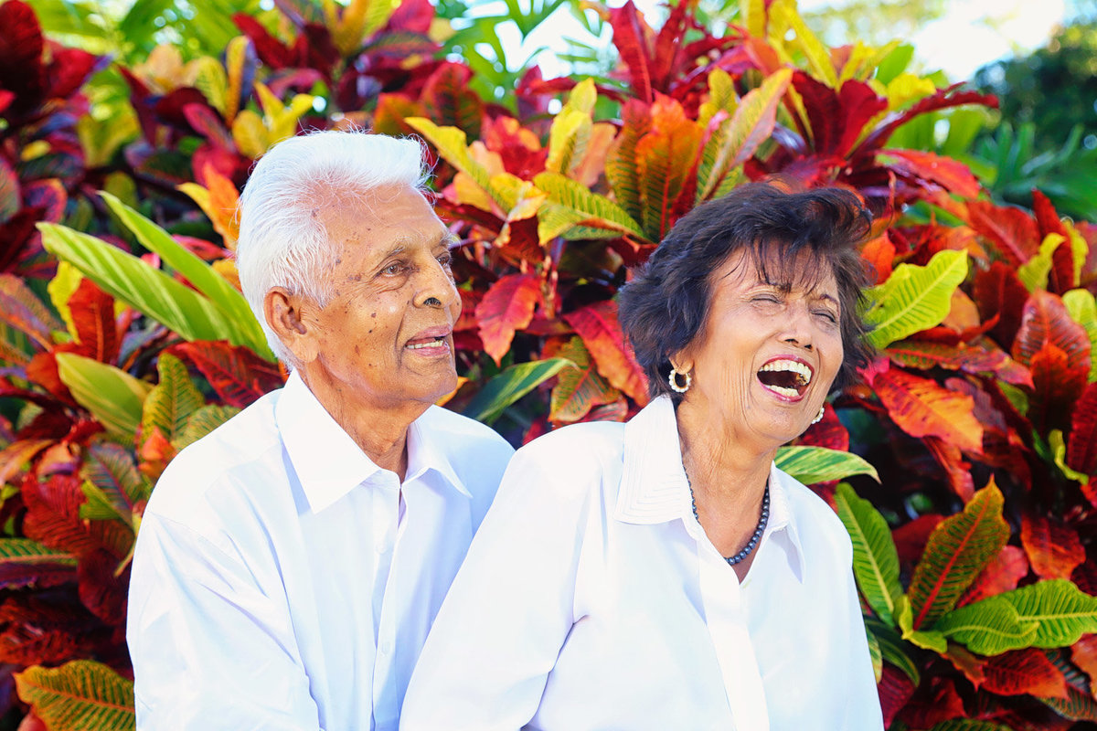 Older man and woman hugging and laughing. Photo by Ross Photography, Trinidad, W.I..