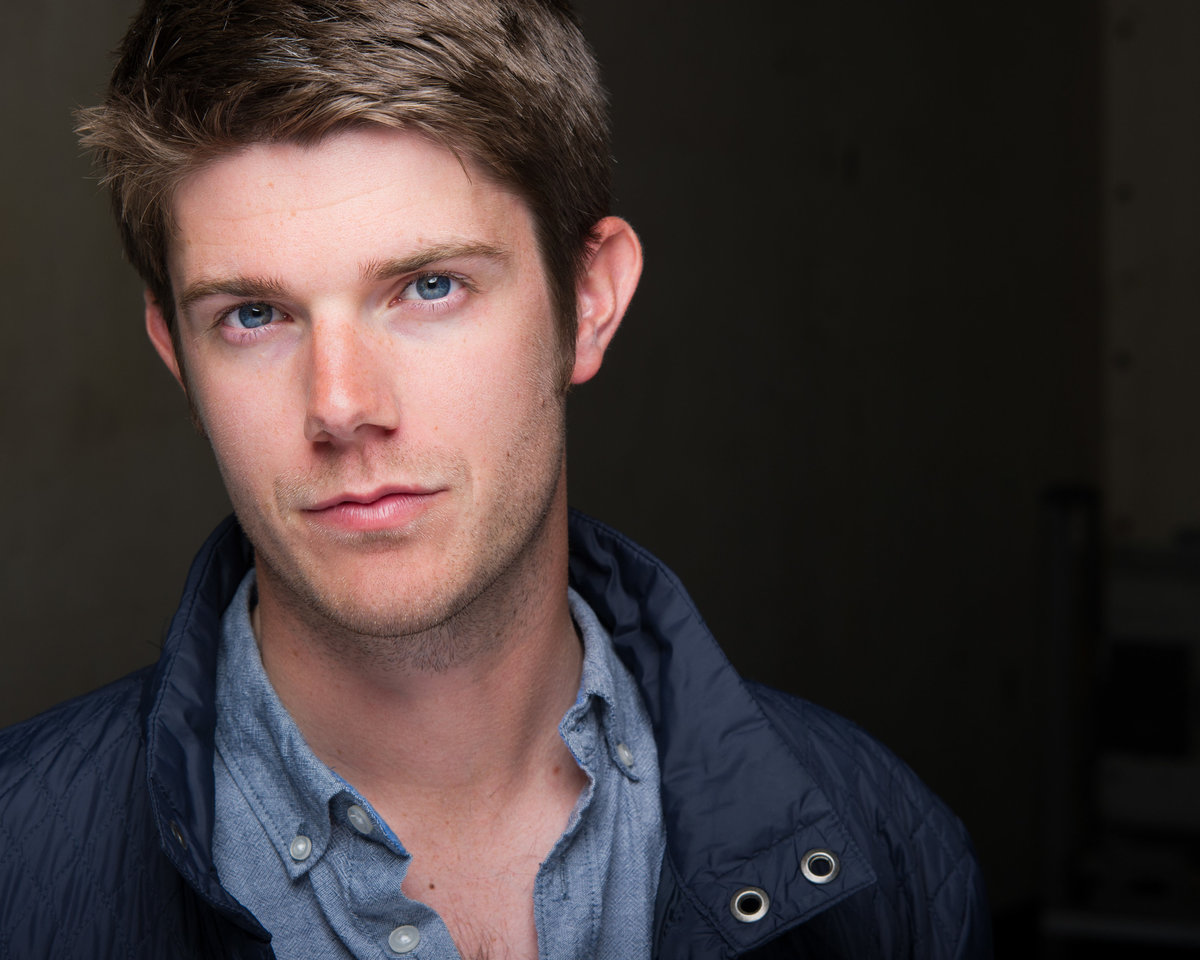 Chicago headshot, male actor in blue shirt and blue jacket.