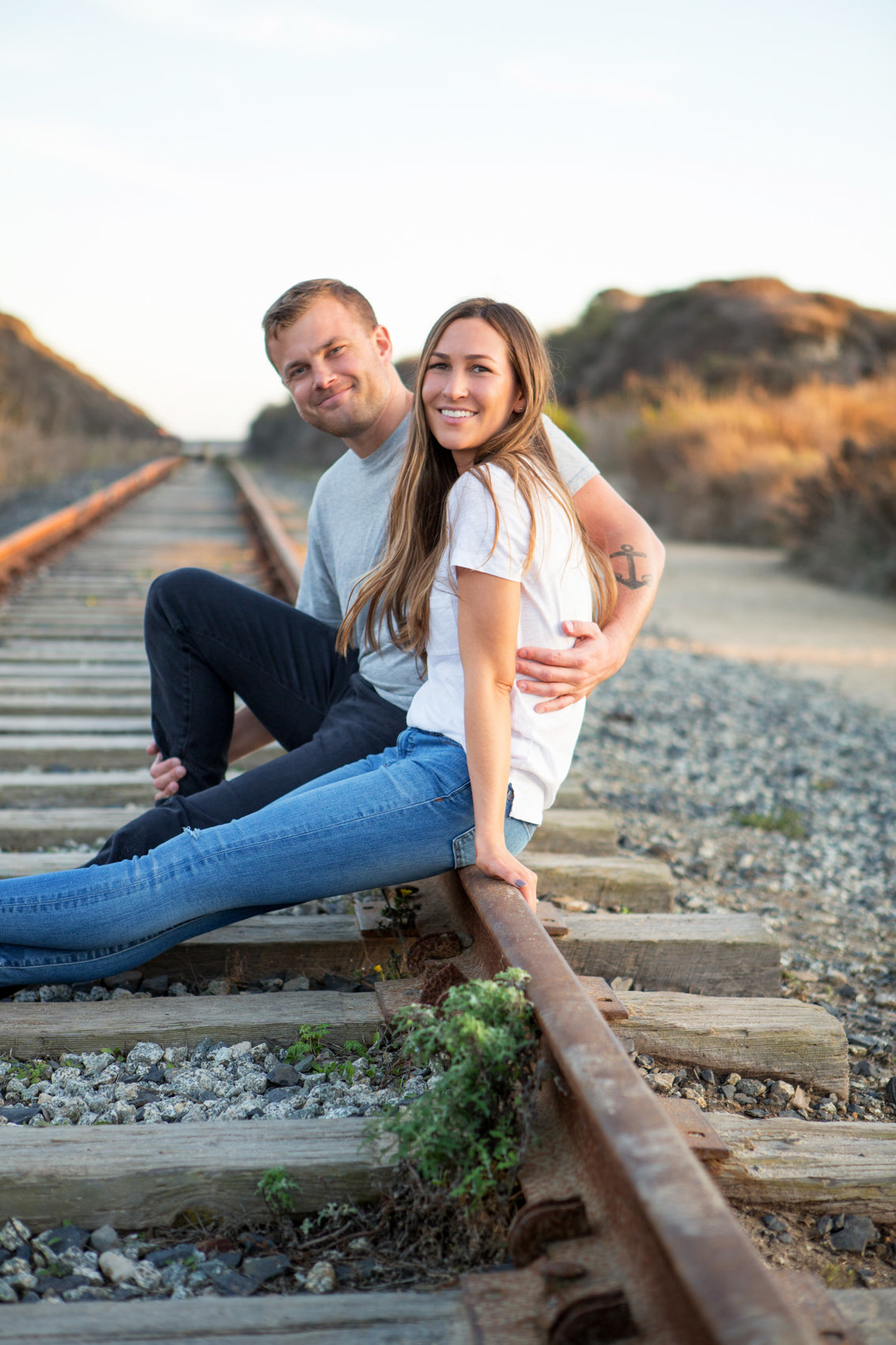 Golden hour engagement session, young couple, davenport california with deneffe studios