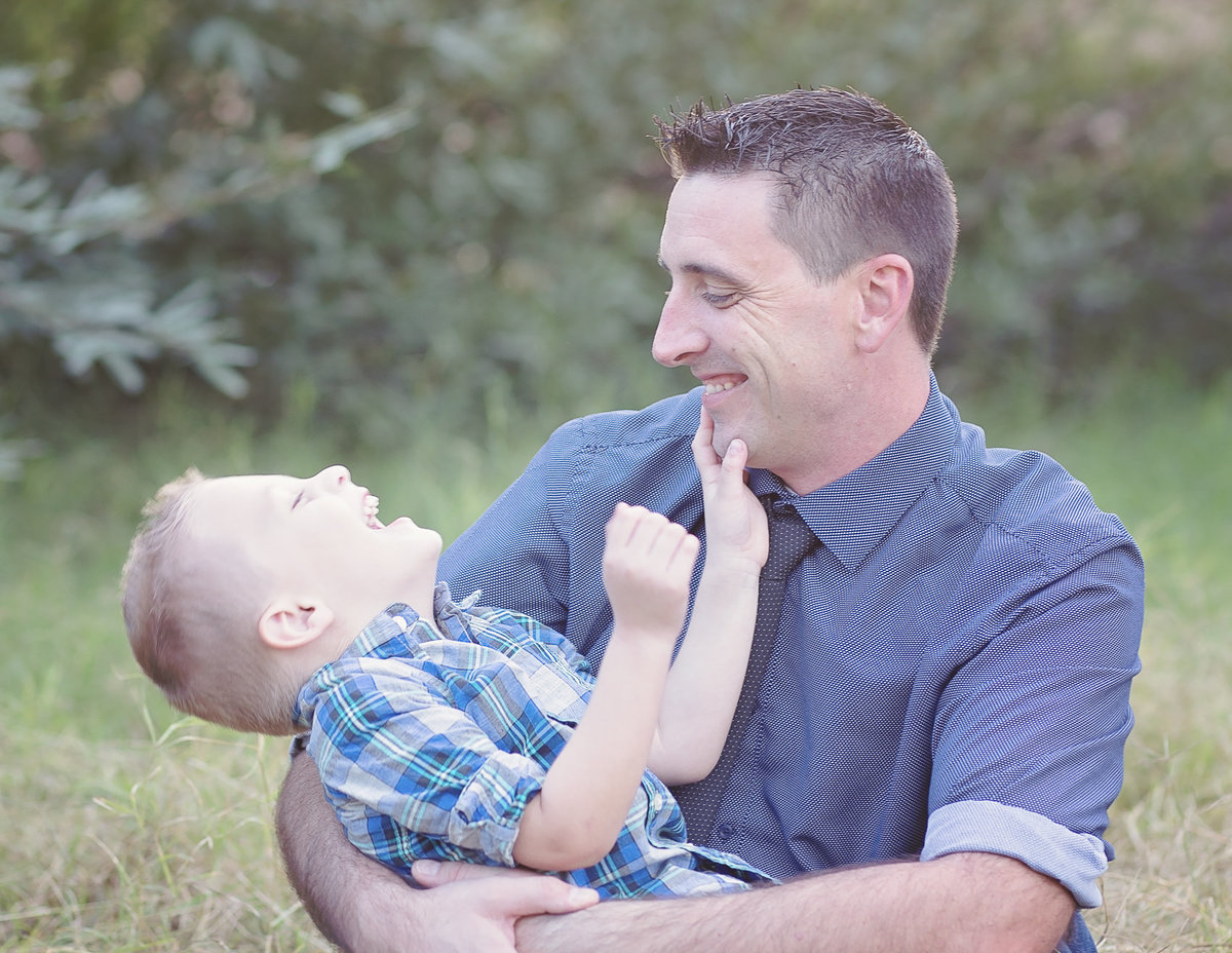Dad and child laughing portrait by Plume Designs & Photography