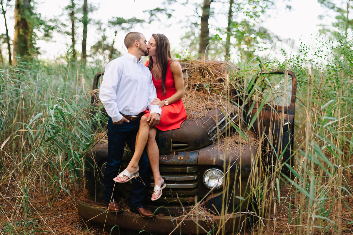 eastern shore md couple kissing on old abandoned truck