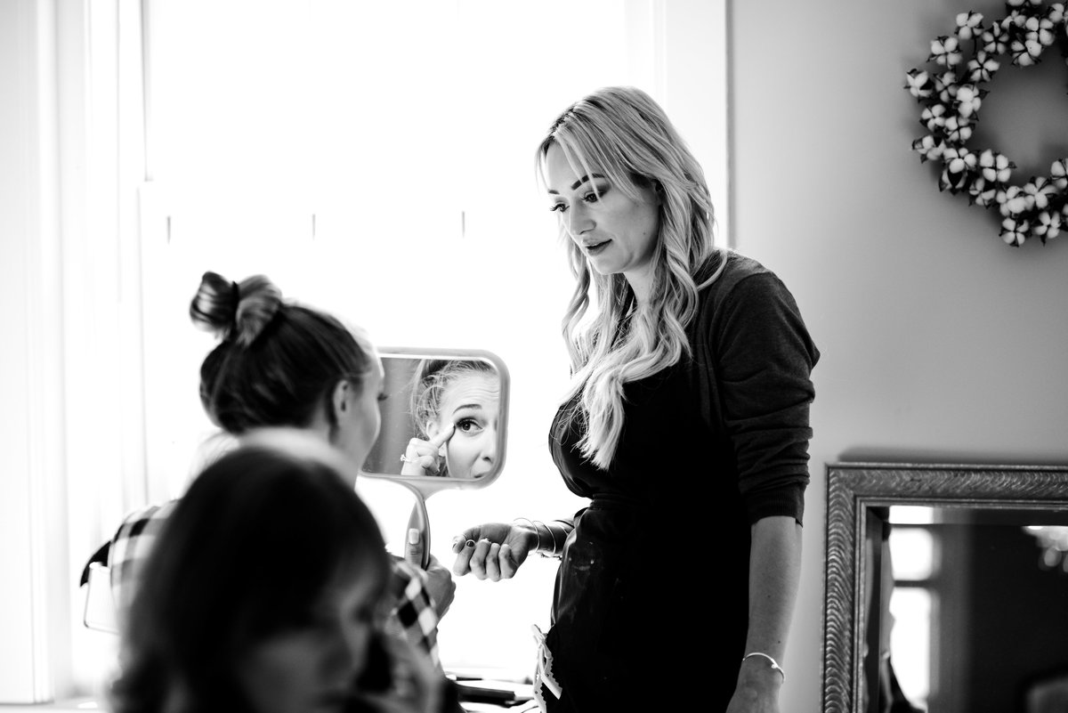 bride getting ready in prep room