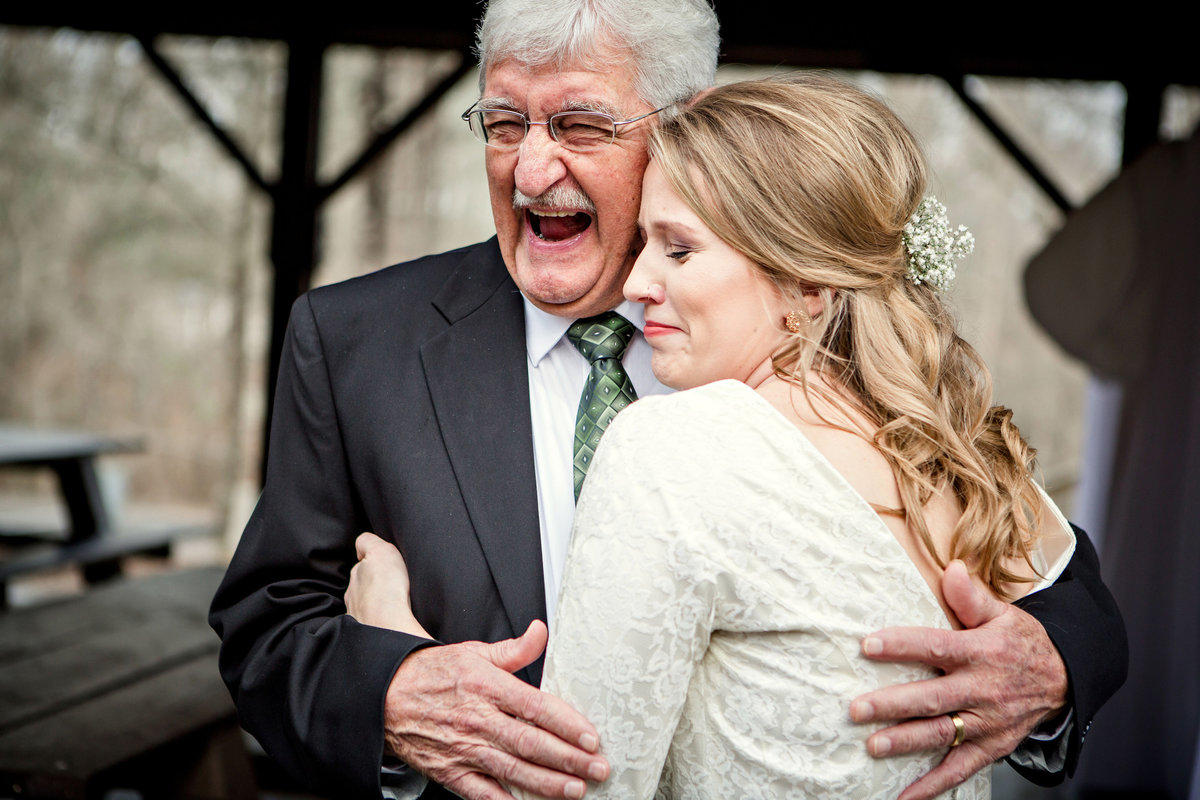Bride hugging her grandfather at Chattanooga Wedding Venue, Red Clay State Park by Knoxville Wedding Photographer, Amanda May Photos.