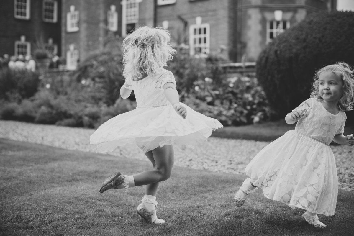 bridesmaids dancing on the lawn at an iscoyd park wedding