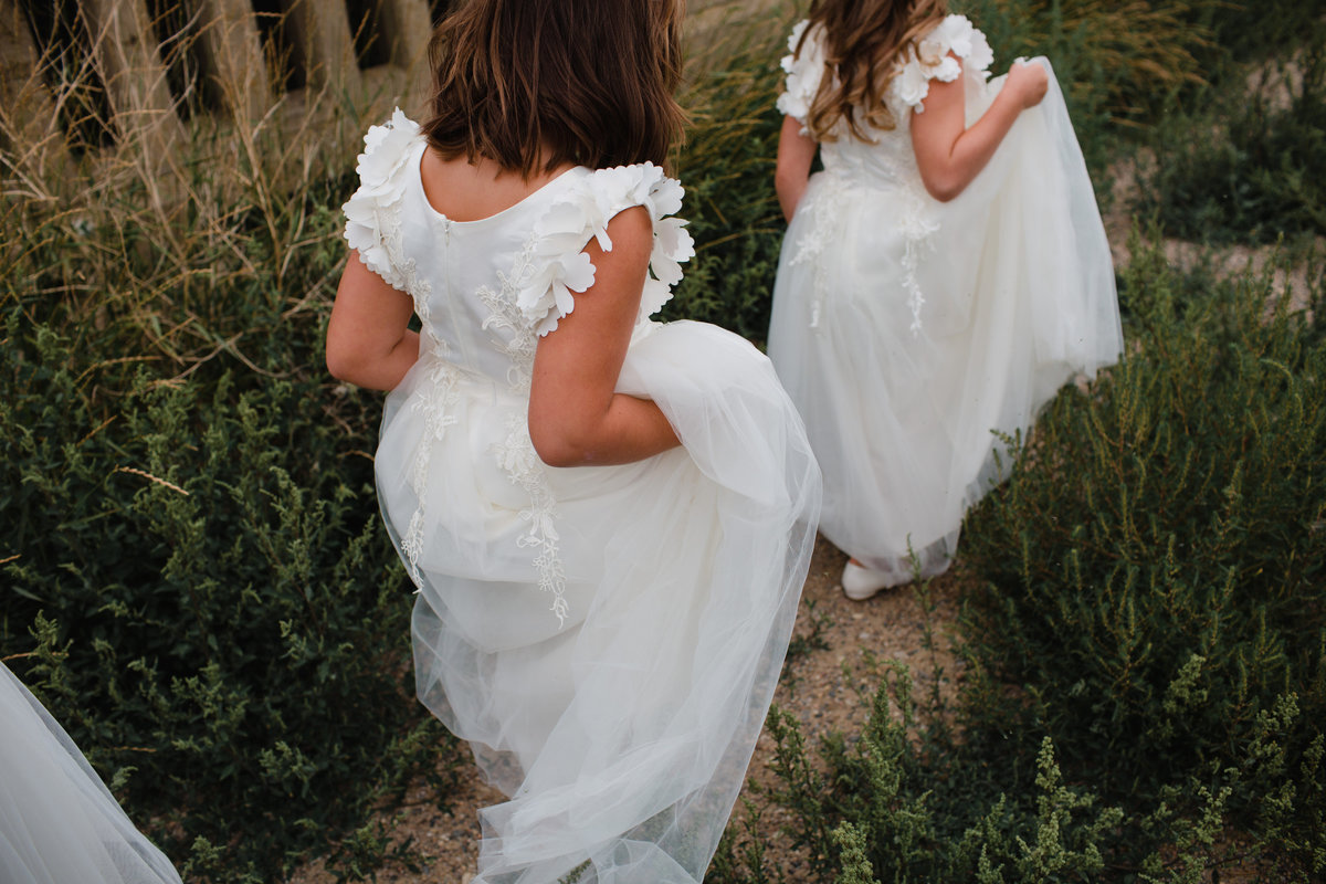 Flower Girls walking through tall grass