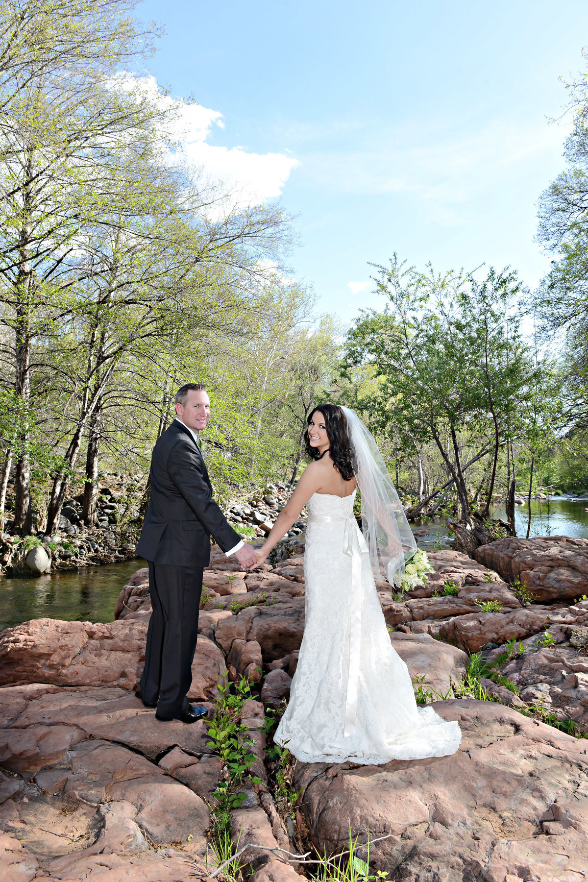 Bride and groom standing by a river in Sedona AZ