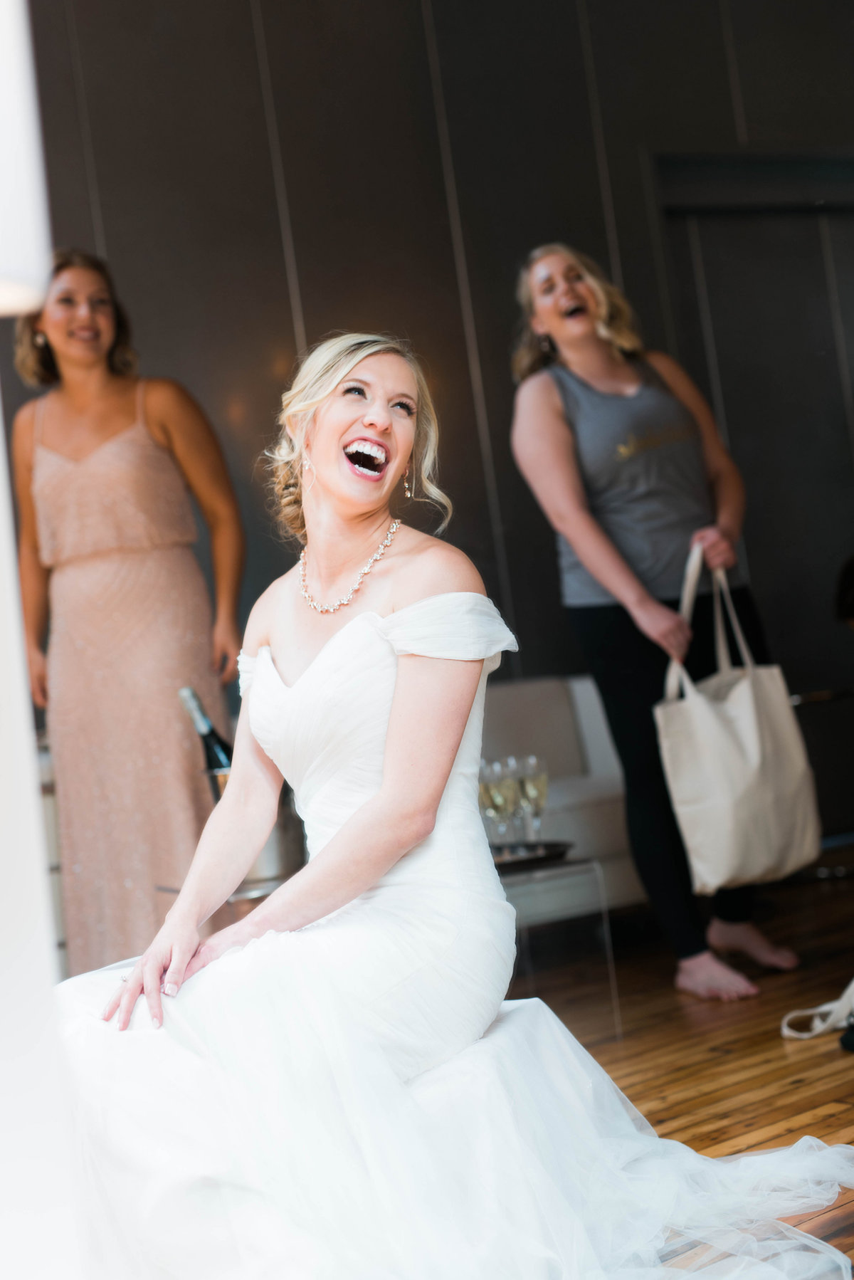 Bride laughing before the ceremony