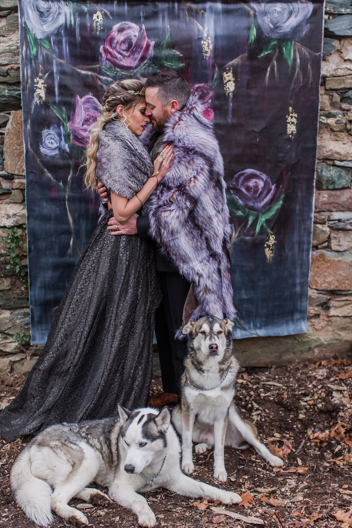 Bride, groom, and huskies in front of custom Game of Thrones inspired wedding backdrop By Brittany Branson as featured on The Perfect Palette