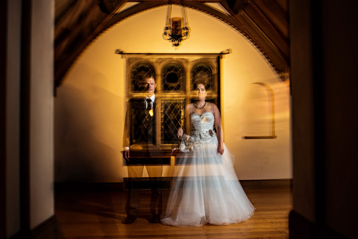 A double exposure of a wedding couple in the haunted venue at gallaher mansion at cranbury park.