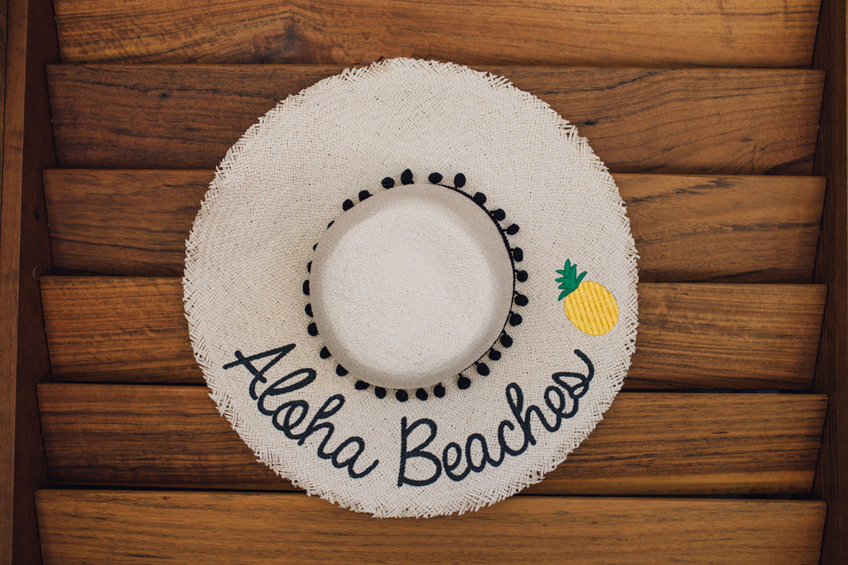 aloha beaches sunhat on a wood shutter