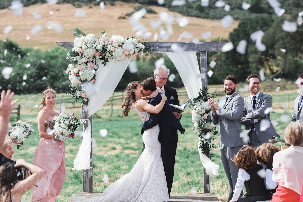 Napa Valley Wedding Photography, First Kiss after the I Do, Confetti Flying at the Alter