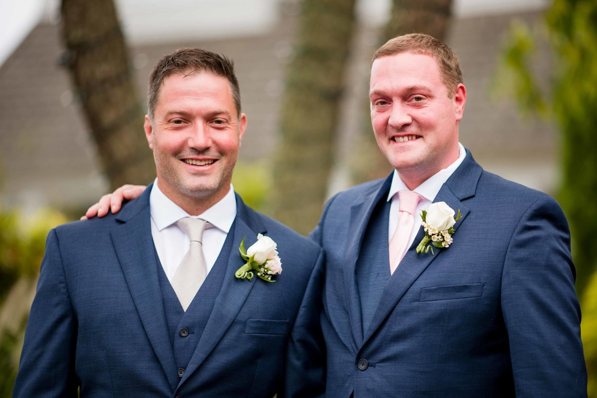 08 Groom and best man in navy suits with white flowers